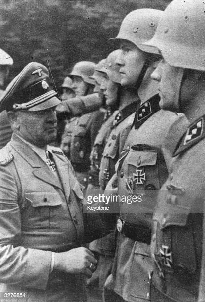 General Sepp Dietrich Obergruppenfuhrer and General of the WaffenSS decorating his troops