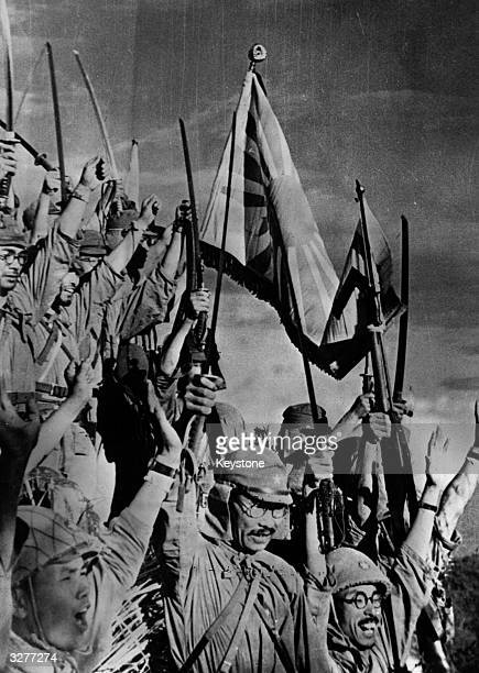 Japanese jubilation Samurai swords brandished in the air and the flag of the Rising Sun proudly held aloft after the capture of Bataan Philippine...