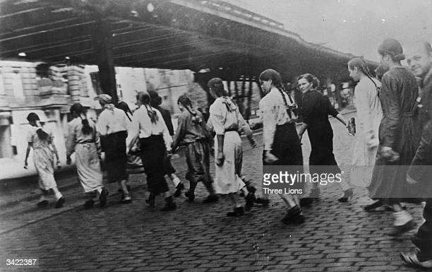 Russian girls captured by the Nazis leave Berlin bound for forced labour camps during WW II