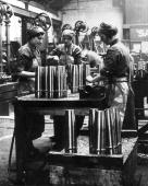 Women munition workers finishing shell cases during World War II