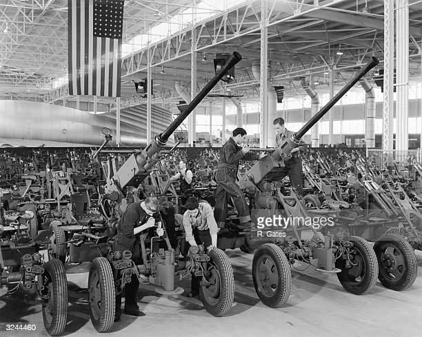 Workers involved in mass production of Bofors 40mm antiaircraft gun mounts and carriages at a Firestone plant in the United States during World War...