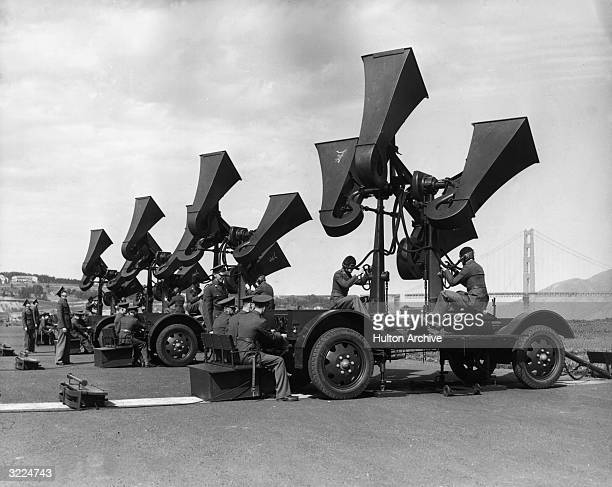 A view of US military personnel operating airplane sound detectors as officers sit and monitor the readings near San Francisco California The men...