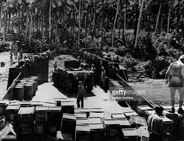 An LCT Landing Craft Tank being loaded with light tanks for a quick dash over to New Georgia from an advanced base in the Central Solomon Islands