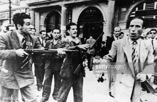 Italian Partisans round up a Fascist sympathiser in Rome