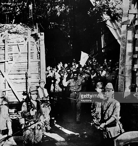 Japanese soldiers march the defenders of Corregidor off to prison camps The surrender of Corregidor after a long period of resistance completed the...
