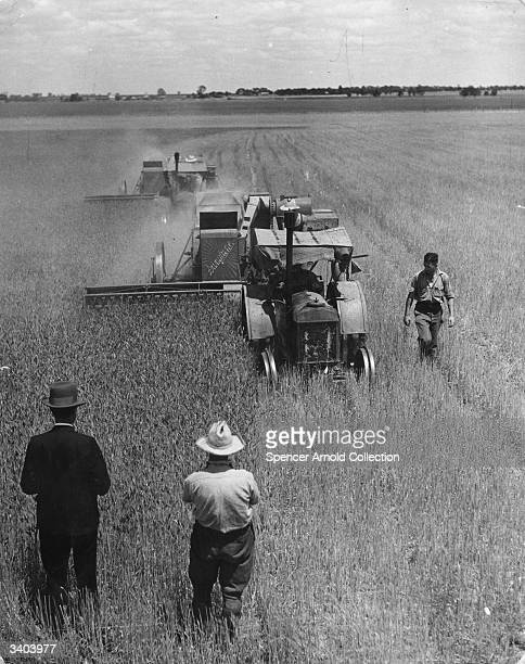 A combine harvester at work on a farm in Australia