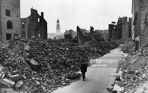 A solitary figure walking through a devastated area of Hamburg during World War II