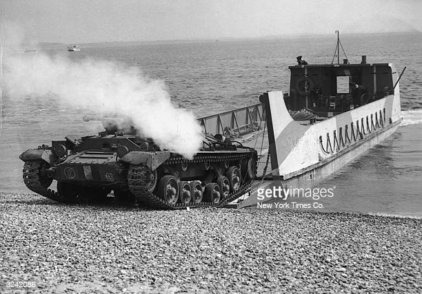 A tank rolls ashore off a landing craft in preparation for an invasion during World War II England