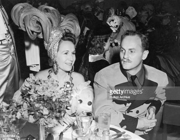 American film executive producer screenwriter and director Darryl F Zanuck sits with his wife Virginia Fox Zanuck during a costume party at Ciro's...