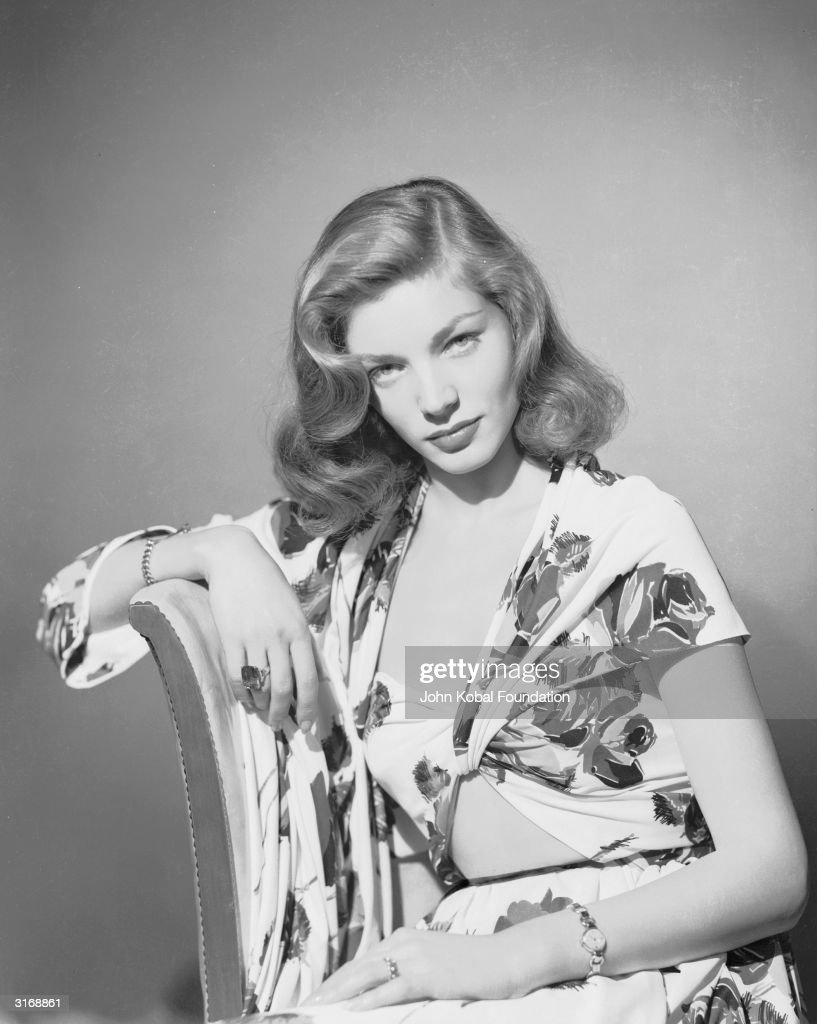 American screen star Lauren Bacall wearing a floral blouse