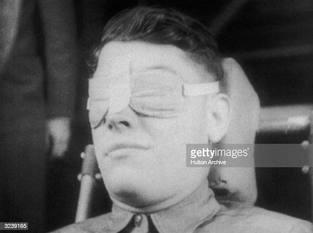 Headshot of a US military test subject undergoing Gforce testing while seated and wearing padded eye protection