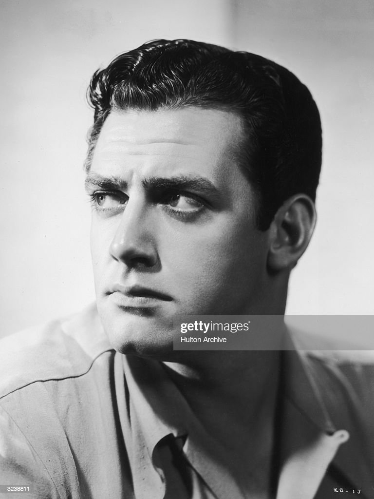 Headshot studio portrait of Canadian actor Raymond Burr looking to the side