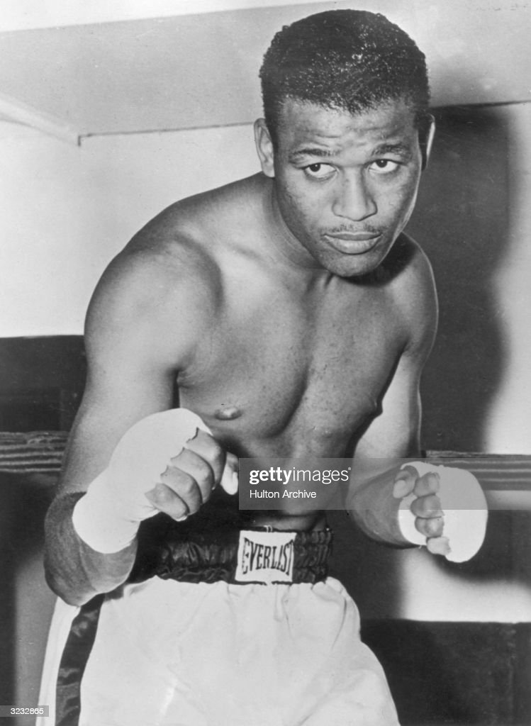 Portrait of American boxer Sugar Ray Robinson welterweight champion from 1946 1951 posing in fight stance and wearing boxing shorts