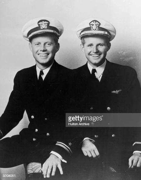 Portrait of young John F Kennedy sitting next to his brother Joseph Kennedy Jr whose plane was shot down in World War II both wearing naval uniforms