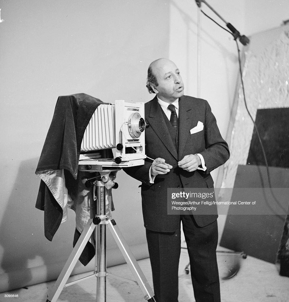 Turkish-born Canadian celebrity portrait photographer Yousuf Karsh (1908 - 2002). (Photo by Weegee(Arthur Fellig)/International Center of Photography/Getty Images)