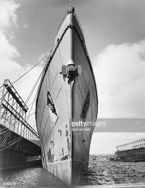 View of the bow of the RMS Queen Elizabeth as seen from the water line while the ship was berthed in New York Harbor New York City