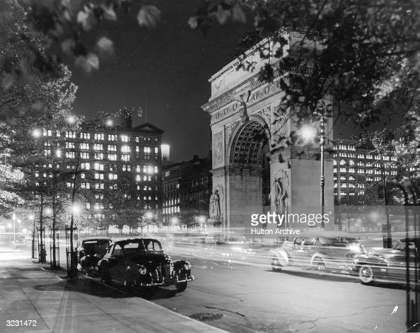 View of the lights of cars at night in front of the Washington Arch in Washington Square Park Greenwich Village New York City