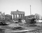 Wrecked vehicles on the Unter Den Linden near the Brandenburg Gate Berlin