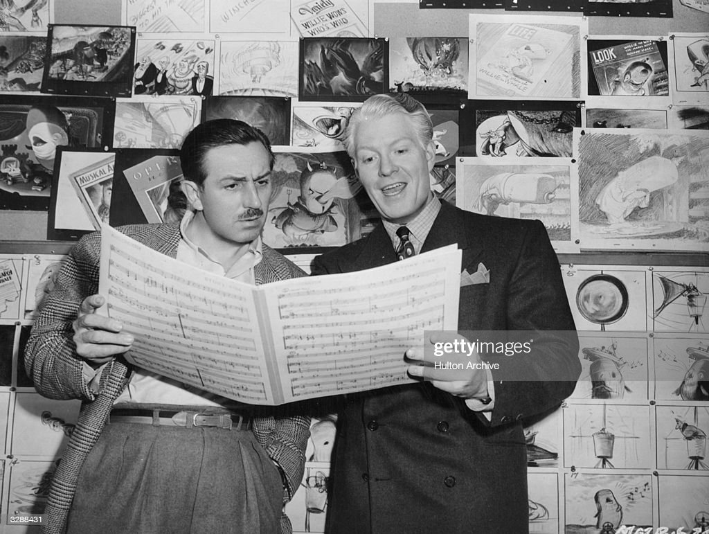 American actor Eddy Nelson scrutinises a music score for the Disney film 'Make Mine Music' a programme of cartoon shorts