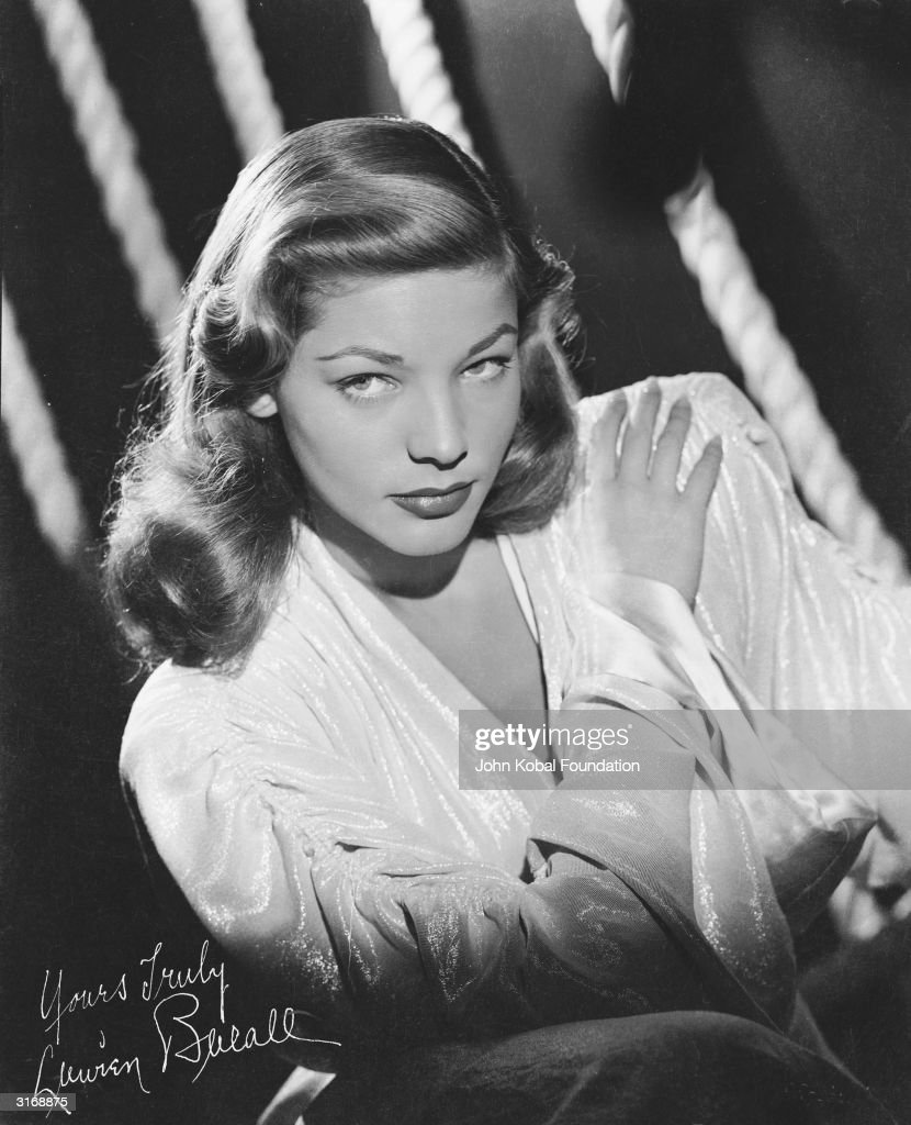 American screen star Lauren Bacall looks up from under her brows in her distinctive manner