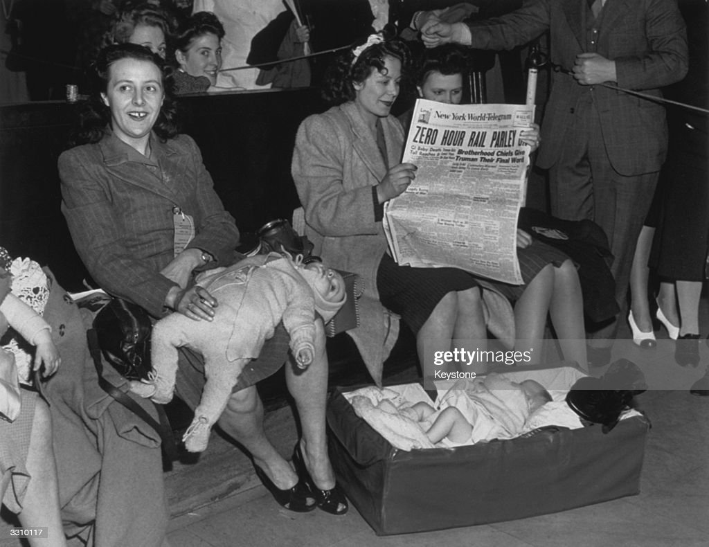 GI brides from Britain who have just landed in New York are victims of a rail strike that stopped all rail movements