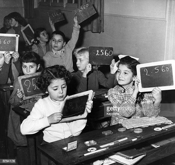 Nicole on the right is holding up her slate with the rest of the class She features as the child of ChoChoSan in 'Madame Butterfly' at the Paris opera