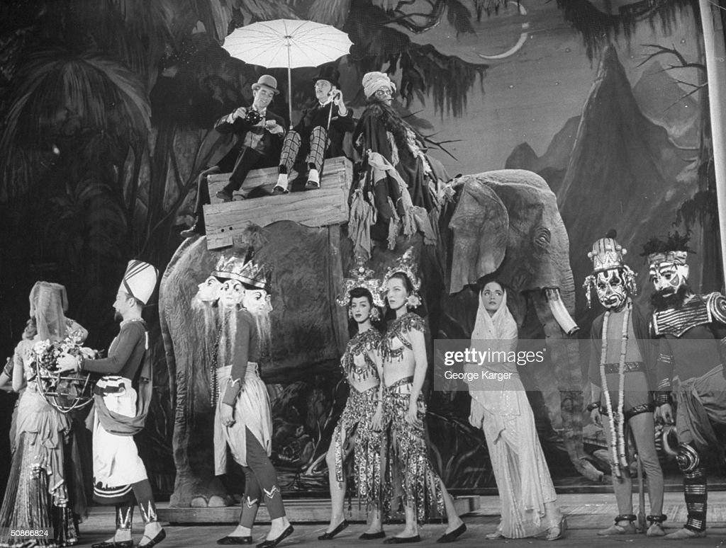 Orson Welles playing an elephant driver in his play 'Around the World.'