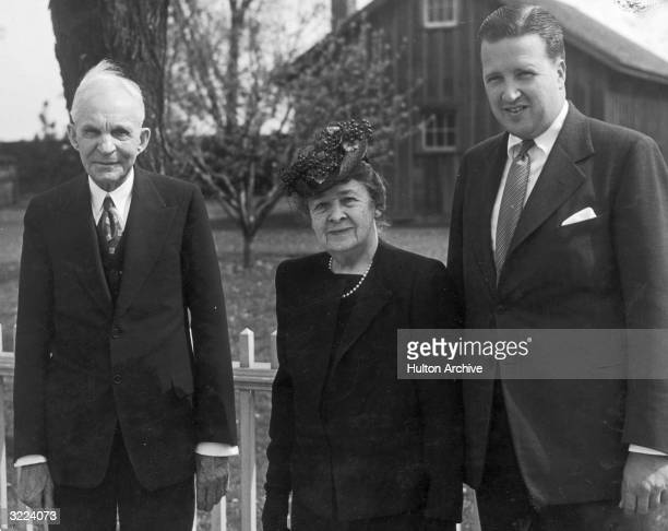 Portrait of American industrialist and inventor Henry posing outdoors with his wife Clara Ford and their grandson Henry Ford II Michigan