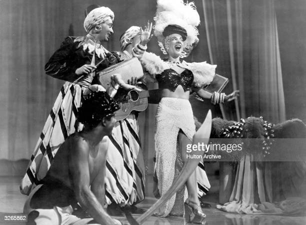 Portuguese actress and entertainer Carmen Miranda in a still from an unknown film