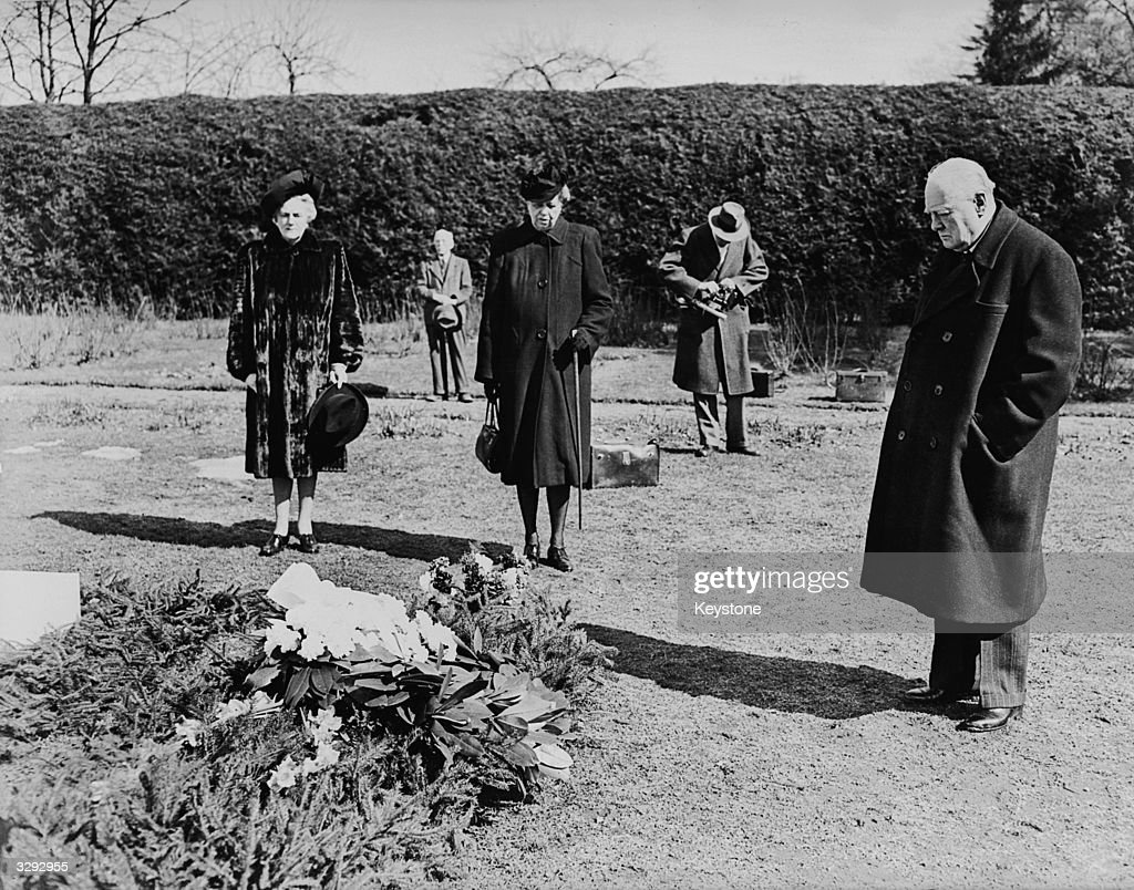 The British statesman Sir Winston Leonard Spencer Churchill (1874 - 1965), the Leader of the Opposition, stands at the graveside of his friend, adviser and partner in the 'Big Three', American President Franklin Delano Roosevelt, (1882 - 1945), at Hyde Park, New York.