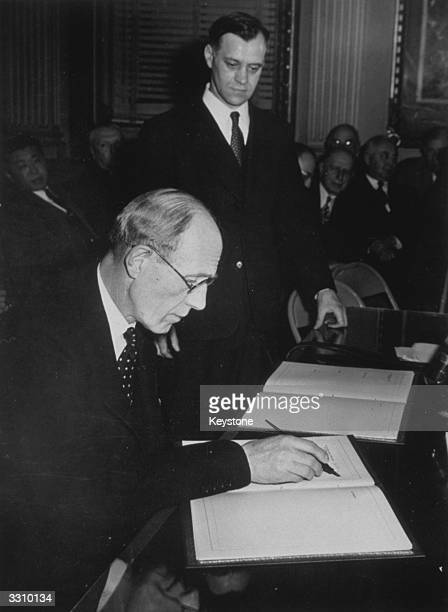 The Earl of Halifax Ambassador from Great Britain signing the Bretton Woods Pacts at the State Department Twentynine nations signed leading to the...