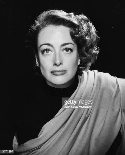 American film actress Joan Crawford wearing a sash