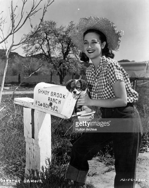 Dorothy Lamour collects an unusual delivery a puppy in her post box on her California ranch