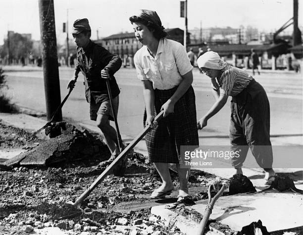Women clearing debris from the streets of Tokyo Japan shortly after the end of World War II
