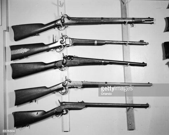 American Civil War Weapons from top to bottom a Confederate 58 calibre musket a Sharps 52 calibre carbine singleshot equipped with target sights a...