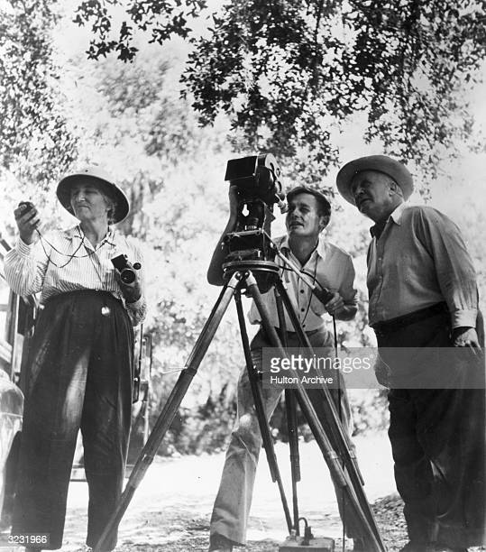 American documentary film director Robert Flaherty stands with his wife and collaborator Frances Flaherty and his cinematographer Richard Leacock...