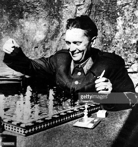 Circa 1948 Yugoslav military leader Marshal Tito seen playing chess
