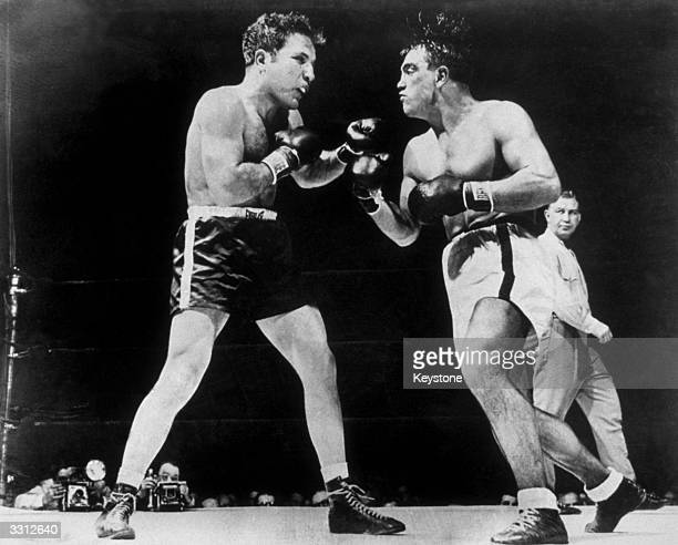 World Middleweight champion Jake La Motta in the ring with Robert Villemain during their 12round bout at Madison Square Garden New York La Motta was...