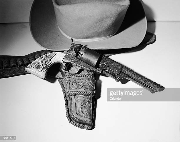 A 44 Colt Dragon with a traditional Cowboy's hat This weapon was originally used in the Mexican War of 18468 and it is typical of the type used in...