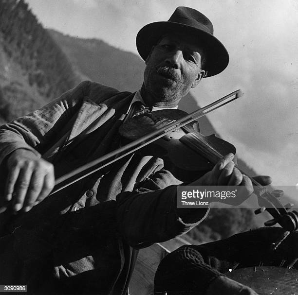 A farmer playing a violin in Romania