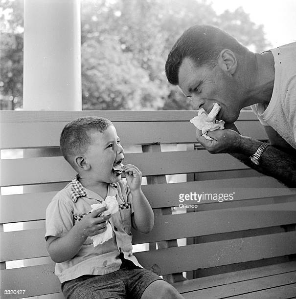 A man and his son enjoy an ice cream each at a family camp on Shelter Island New York State