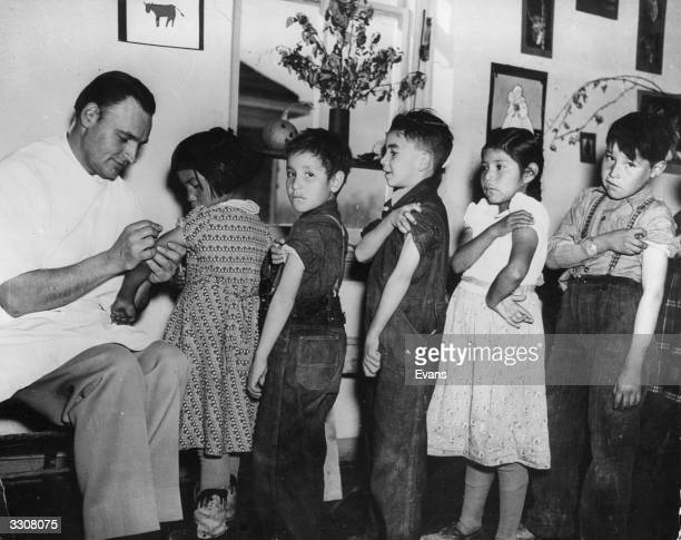 A Native American doctor vaccinates Native American children at the school on the Wind River Reservation in Wyoming