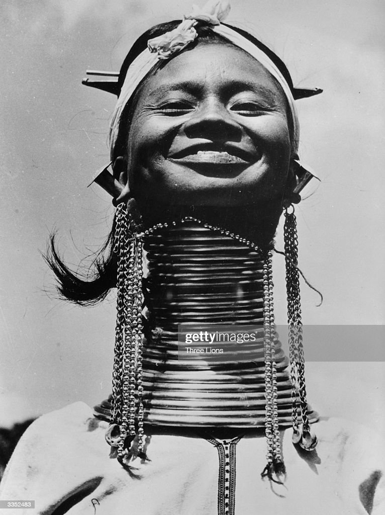 A Padaung, or Kayan woman. Originally a Mongolian tribe, the Padaung have been assimilated into the Karen group native to Mayanmar (Burma). The most stiking feature of these people are the brass rings fitted to the necks and limbs of women born on Wednesdays. The first neck ring is fitted when they are five or six, with successive rings fitted every two years, denoting the status of their family.