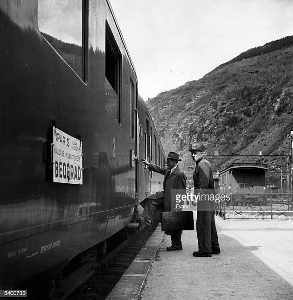A passenger boards the Orient Express during its journey through Yugoslavia on its way to Istanbul Service on the luxury train becomes rather more...