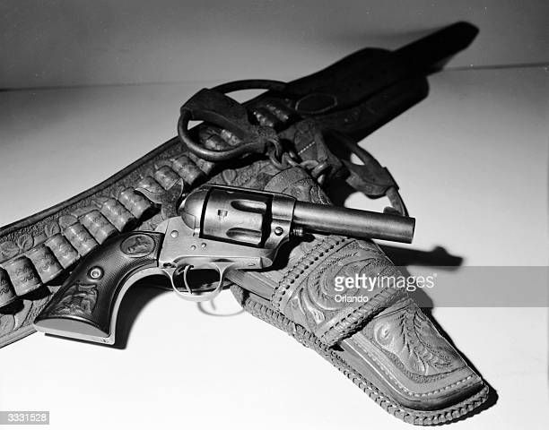 A 'Sheriff's Model' 44 Colt sawnoff barrel revolver used by law enforcement officers in the American 'Wild West' during the 1890's and an open...
