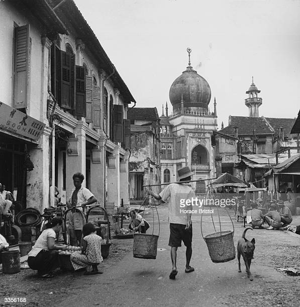 A street leading to a mosque in the port of George Town or Pinang capital of the island state of Pinang north west Malaysia
