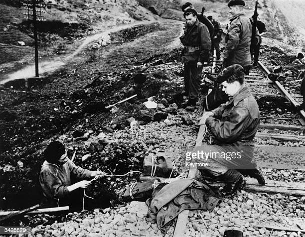 A team of commandos prepare to blow up a railway line behind enemy lines during the Korean War