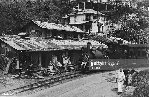 A train approaching Darjeeling on the miniature railway from Siliguri a climb of 7000 feet