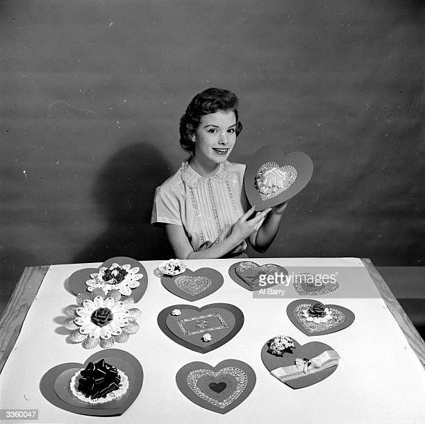 A woman making heartshaped homemade cards for her sweethearts on Saint Valentine's Day