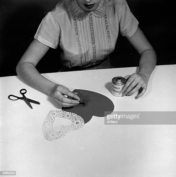 A woman making homemade cards for her sweetheart on Saint Valentine's Day